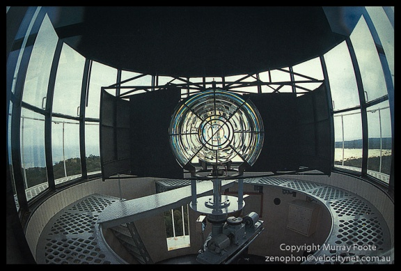 Sandy Cape optic. Nikon FE with 16mm f3.5 AI fisheye lens, Fujichrome 50.(Low res scan from book).