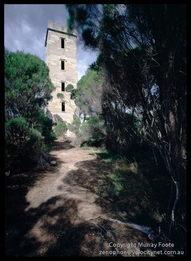 "Ben Boyd lighthouse.  10.30am 7th April 1987.   Arca-Swiss monorail 5x4"",  f32 1/20 second + polariser, 65mm Schneider Super Angulon, Fujichrome 50."