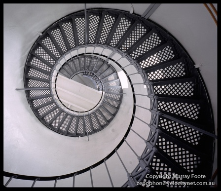 "Cape Bruny lighthouse stairs from floor 10:00am 3 April 1987 Nagaoka Field Camera 5x4"" 65mm Schneider super Angulon,  f45 65 seconds, Fujichrome 50."