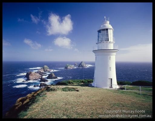 "Maatsuyker lighthouse and rocks from cliff edge 2:00pm 22 April 1987 Nagaoka Field Camera 5x4"" 65mm Schneider Super Angulon f16 1/30 second + polariser Fujichrome 50"