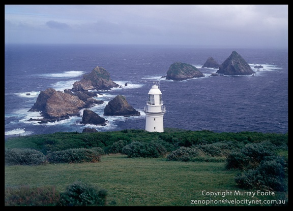 "Maatsuyker lighthouse and rocks from in front of cottages 1:30pm 22 April 1987 Arca Swiss Monorail 5x4"" 150mm Linhof Schneider Technika Symmar  f16 1/30 second + polariser Fujichrome 50"