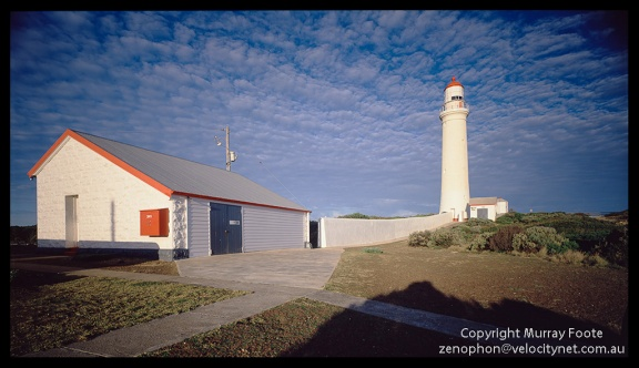 "Cape Nelson shed and lighthouse 7:20am  3 May 1987 Arca-Swiss 5x4"" monorail camera 90mm Linhof Angulon f22 1/4 second + polariser Fujichrome 50"